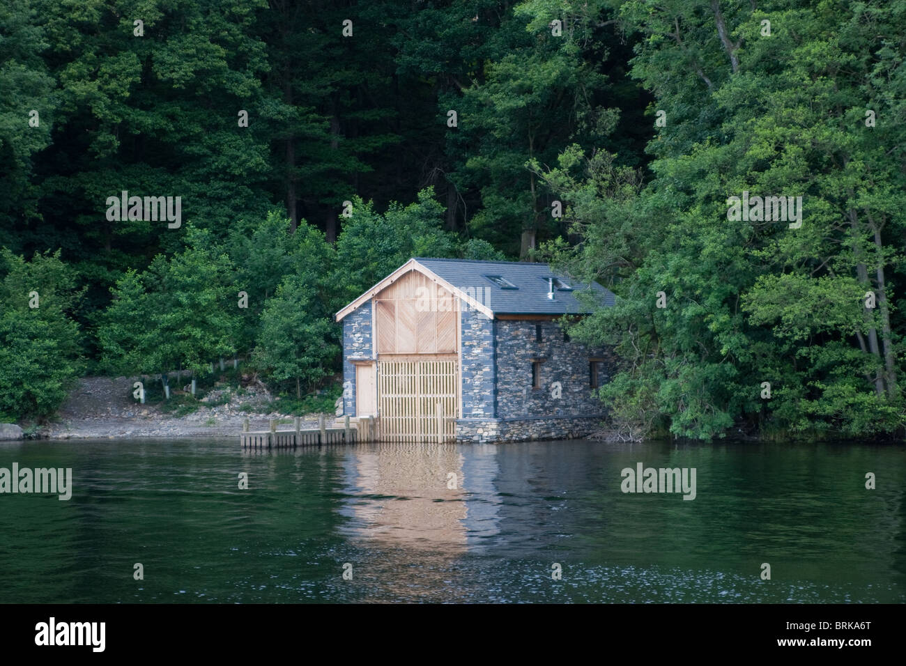 A boathouse on the shore of Lake Windermere, in the Lake District, Cumbria - Stock Image