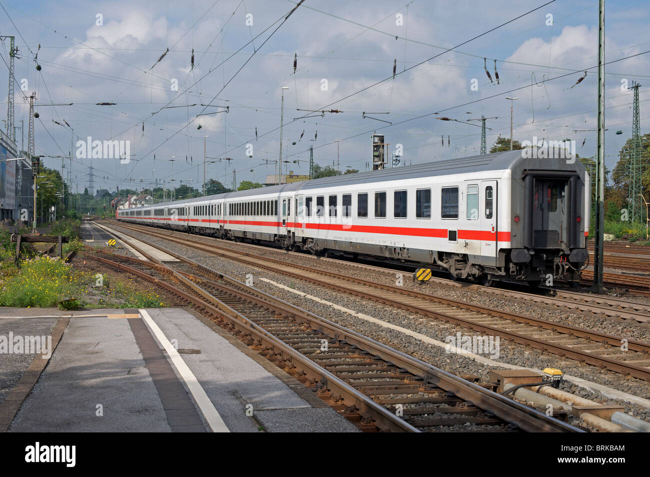 Intercity (IC) passenger train leaving Solingen, North Rhine-Westphalia, Germany. - Stock Image