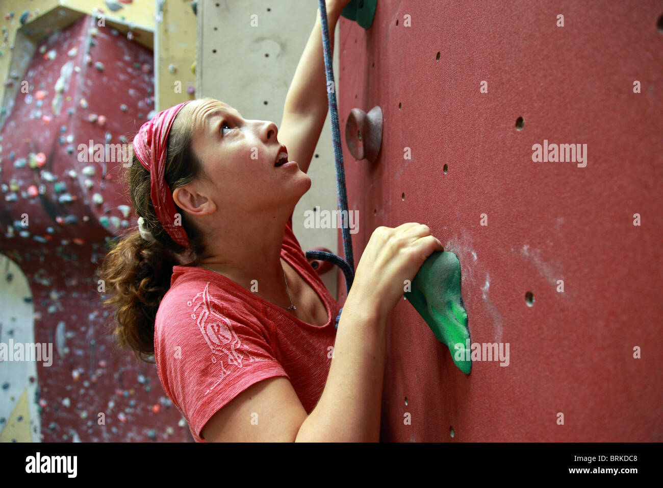 Girl in indoor climbing wall - Stock Image