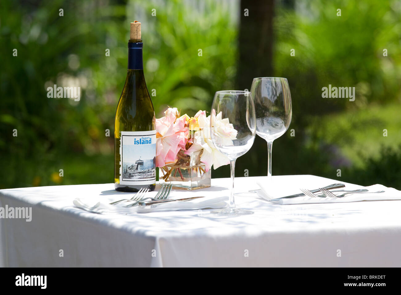 Wine Glasses And Wine Bottle On Table With White Table Cloth Outside Stock Photo Alamy
