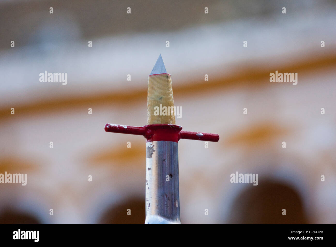 sharp dagger type blade used in bull fighting scene in sevilla, spain - Stock Image