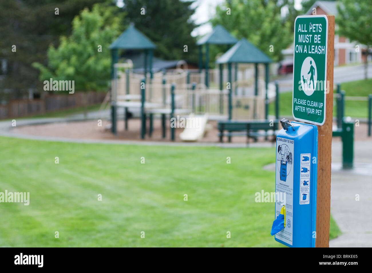 Bags are provided for responsible pet owners to keep the park clean. - Stock Image