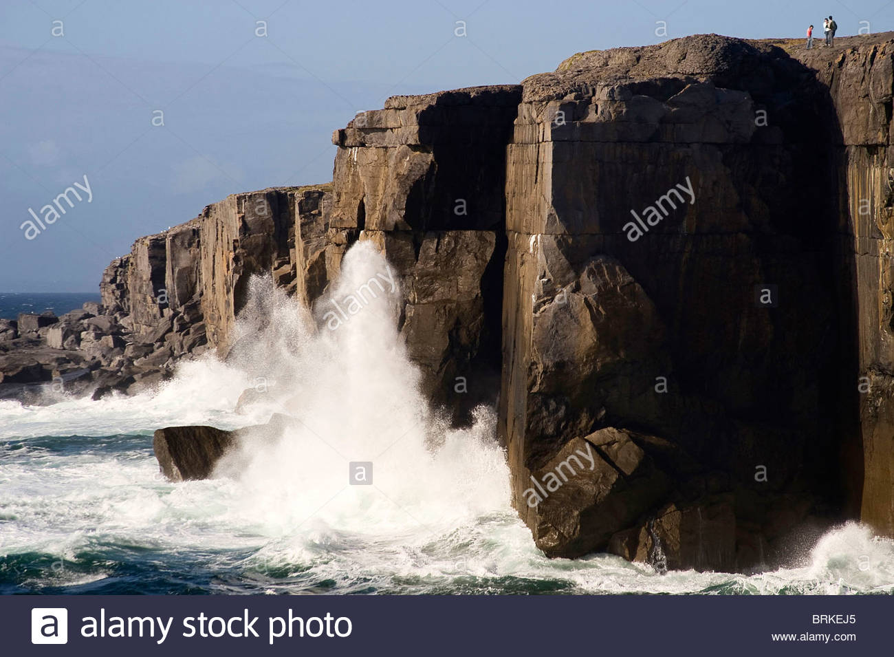 Waves crashing against rocks at The Burren, County Clare - Stock Image