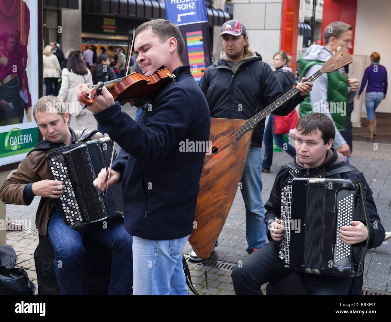 Cologne buskers - Russian classical quarter with bass balalaika, violin and two accordions - Stock Image
