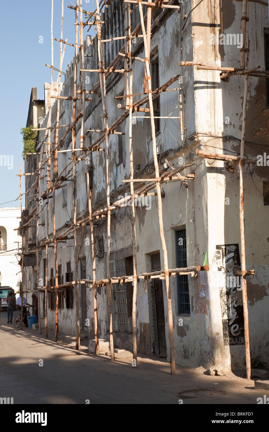 Zanzibar, Tanzania. Scaffolding of Mangrove Poles, Stone Town. - Stock Image