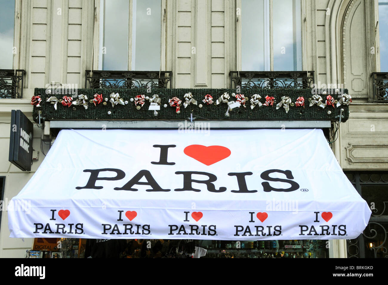 Shop window blind awning sunblind showing the legend I Love Paris with heart shape in red. - Stock Image