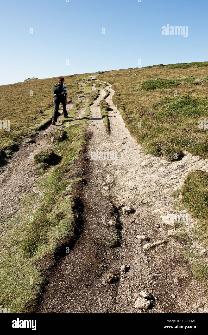 A walker on the South West coastal path in Cornwall. - Stock Image