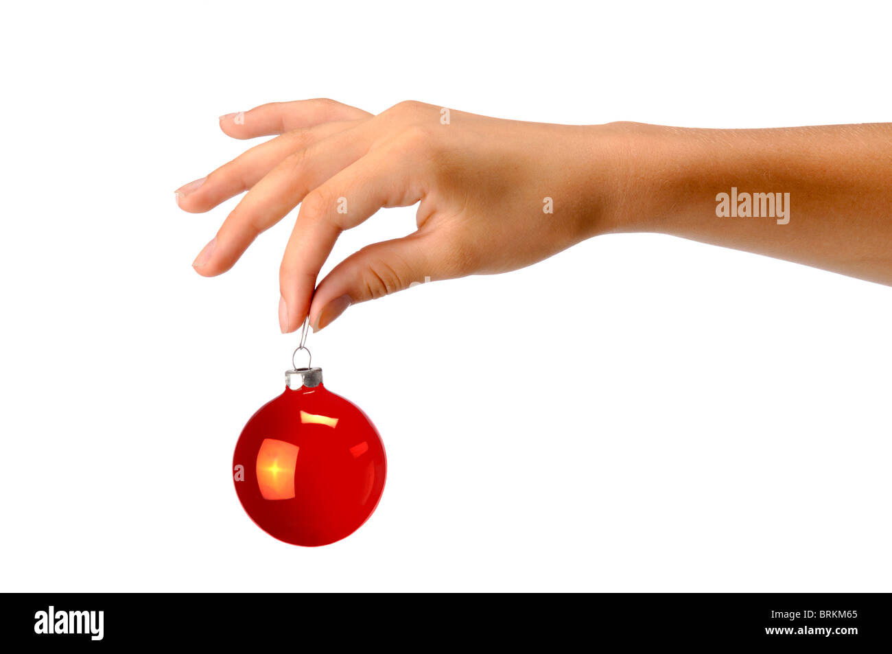 hand holding red christman ornament - Stock Image