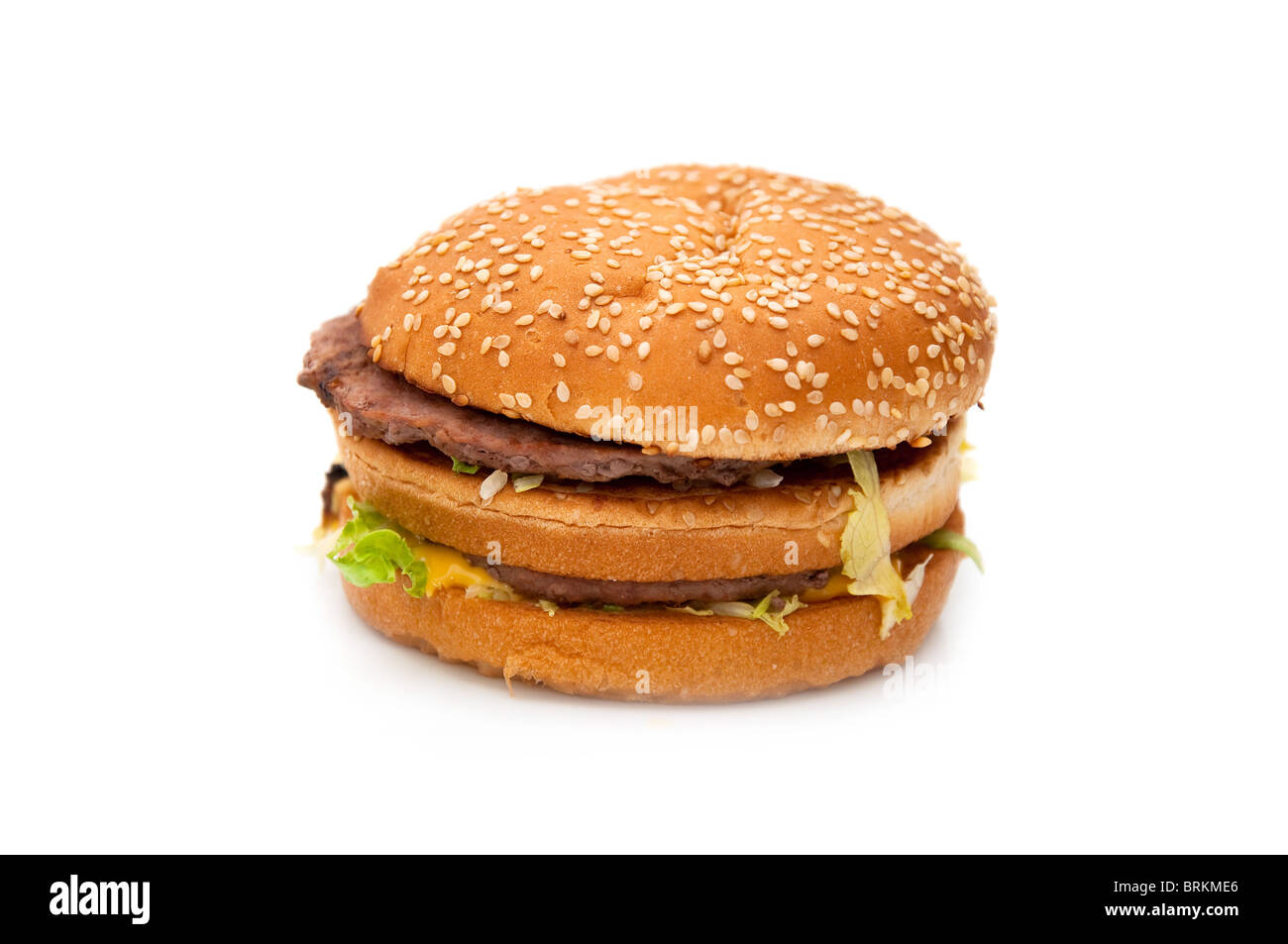 a tasty hamburger over white background. unhealthy junk food. Stock Photo