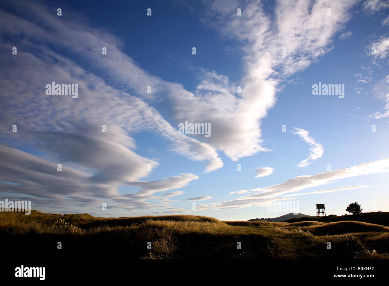 Dramatic clouds over Southgate Dunes Sandy Lane Water Tower and Cefn Bryn  Gower South Wales UK - Stock Image