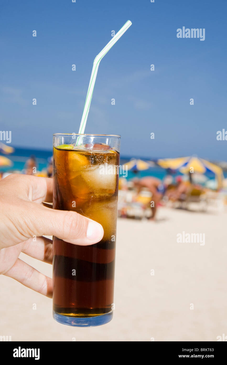Cola drink with beach background - Stock Image