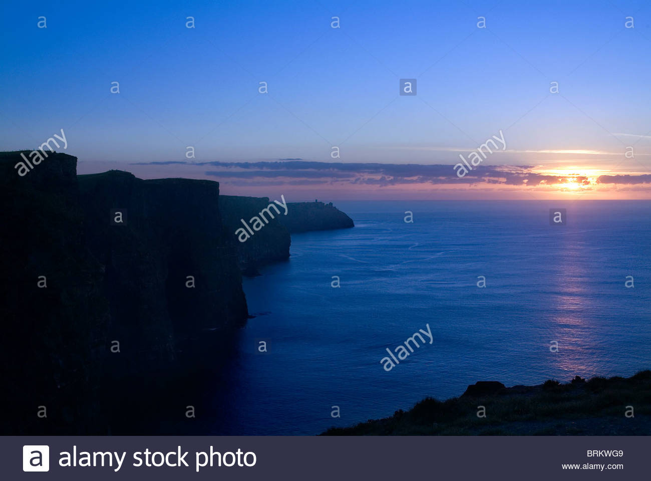 Sunset over the Atlantic from the Cliffs of Moher - Stock Image