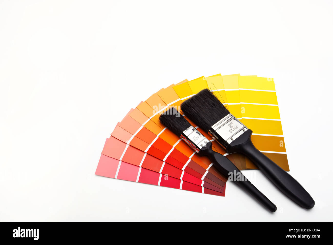 Paint Brushes With Red Yellow Orange And Brown Colour Swatches