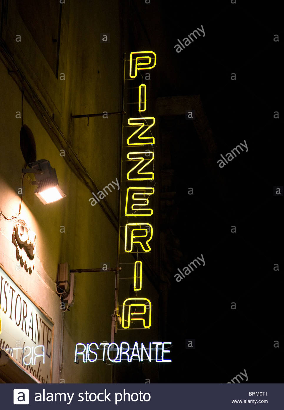 Neon Restaurant sign at night Stock Photo
