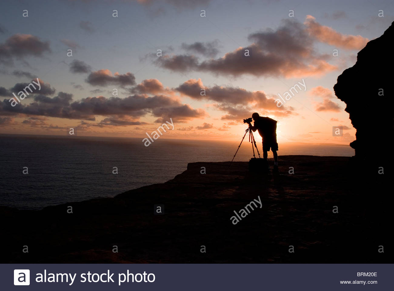 Photographer at the Cliffs of Moher in Ireland - Stock Image