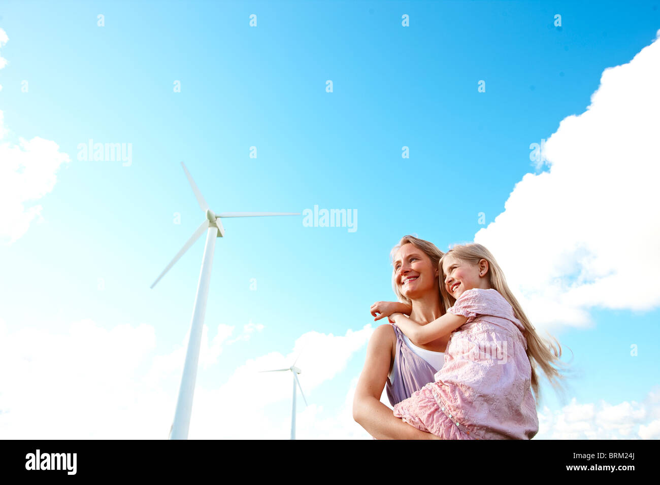 Mother and daughter at wind turbine - Stock Image