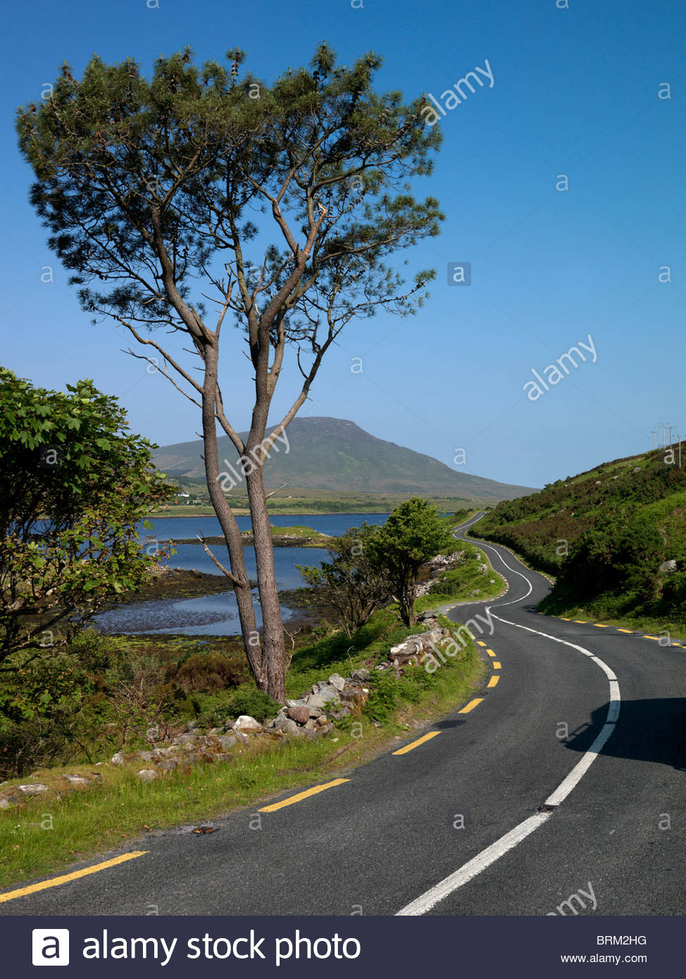 A country road in Mayo on the west coast of Ireland. - Stock Image