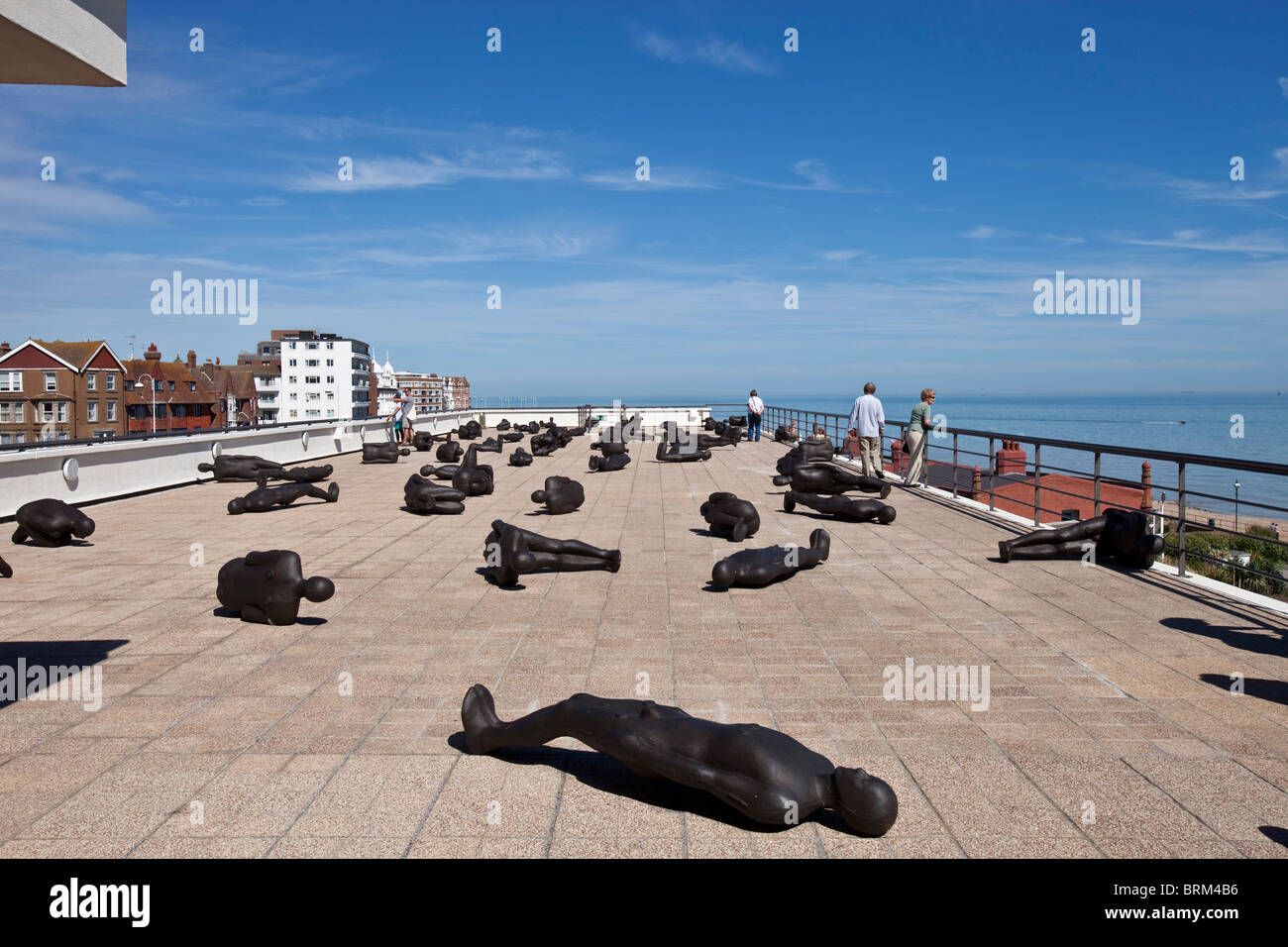 'Critical Mass' an exhibition by the sculptor Antony Gormley on the roof of the De La Warr Pavilion, Bexhill - Stock Image