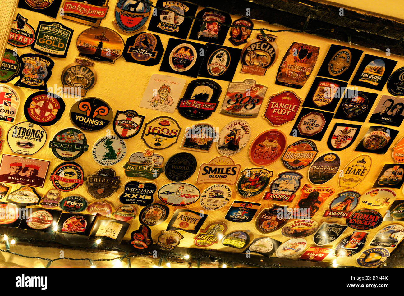 Display of beer mats in an English pub - Stock Image