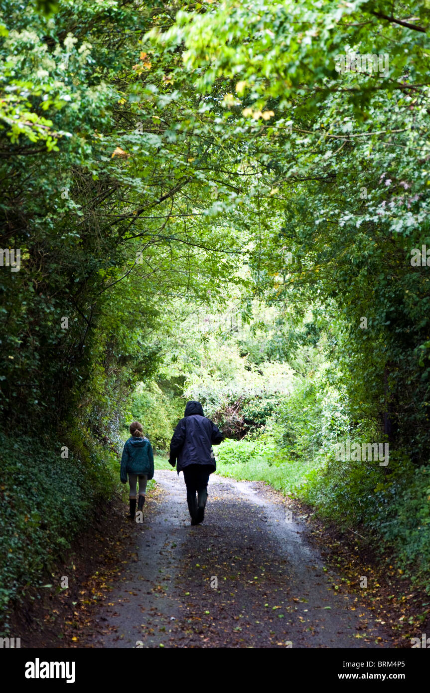Mother and daughter walking in a country lane - Stock Image