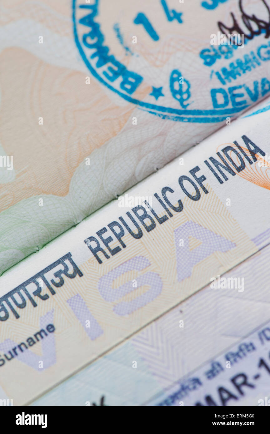 Indian visa in a british passport with immigration stamp - Stock Image