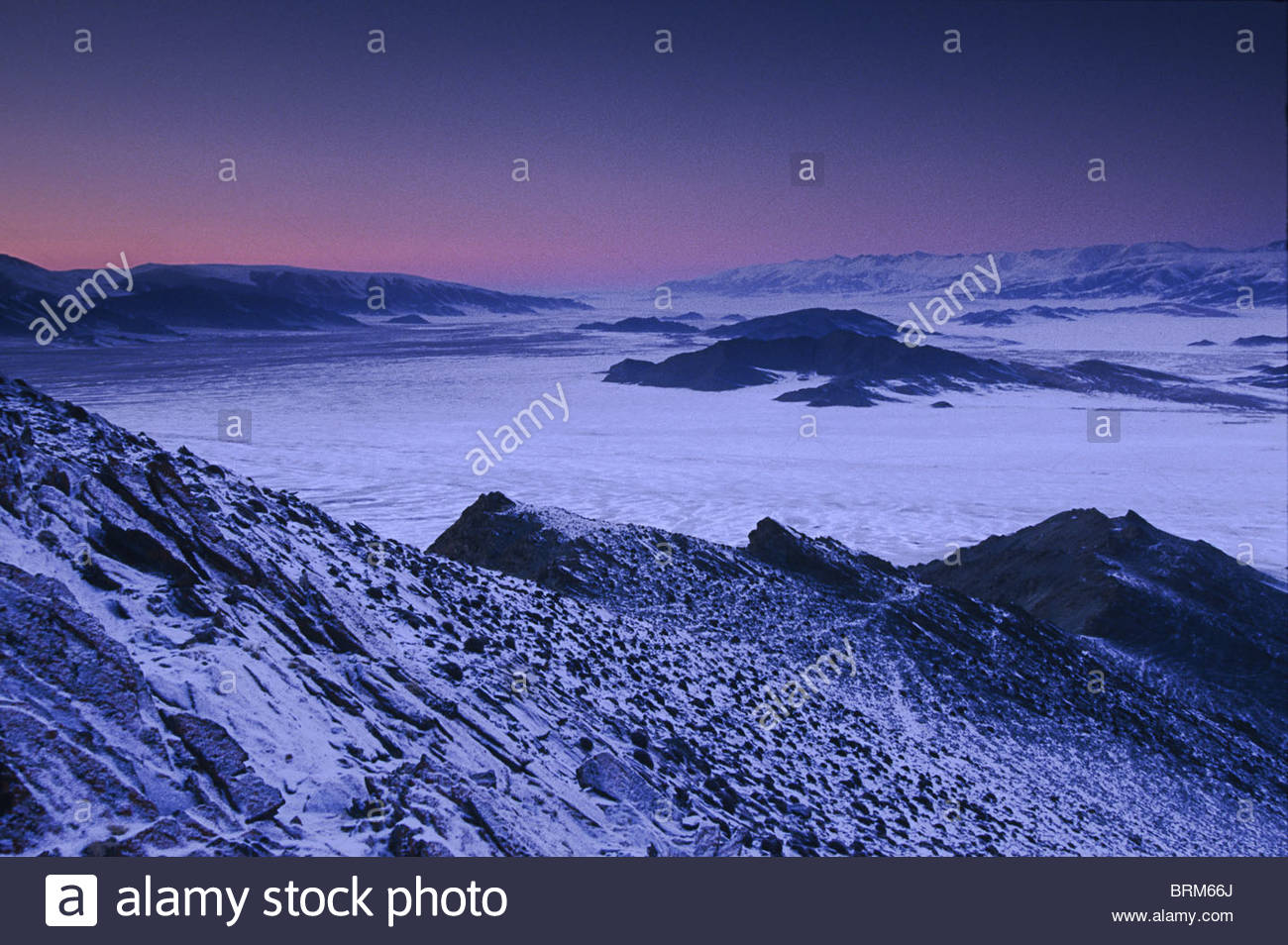 Winter landscape at dawn in a valley Stock Photo