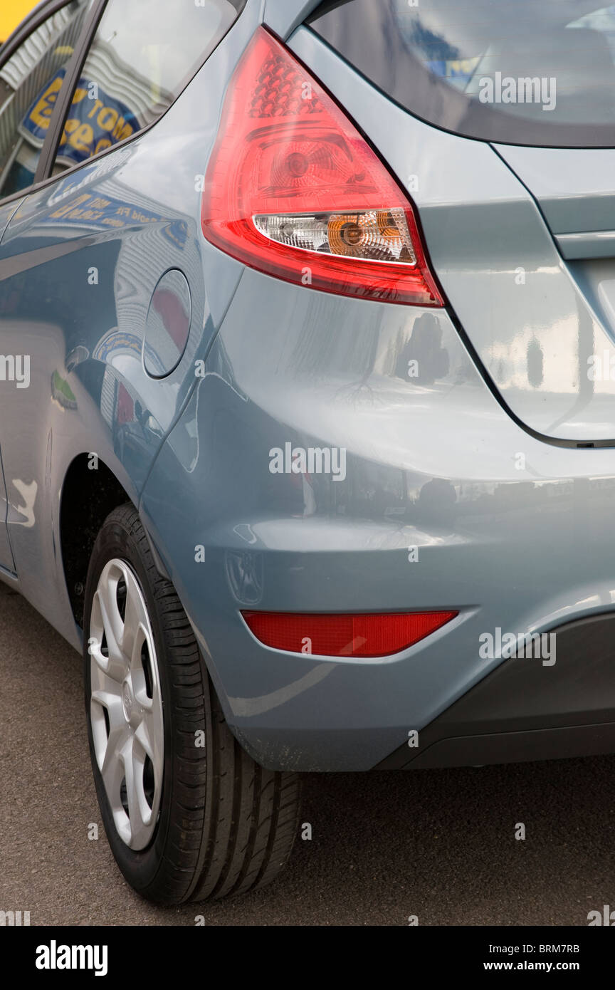 Close up view of rear of a ford fiesta city car showing rear light cluster detail. Stock Photo