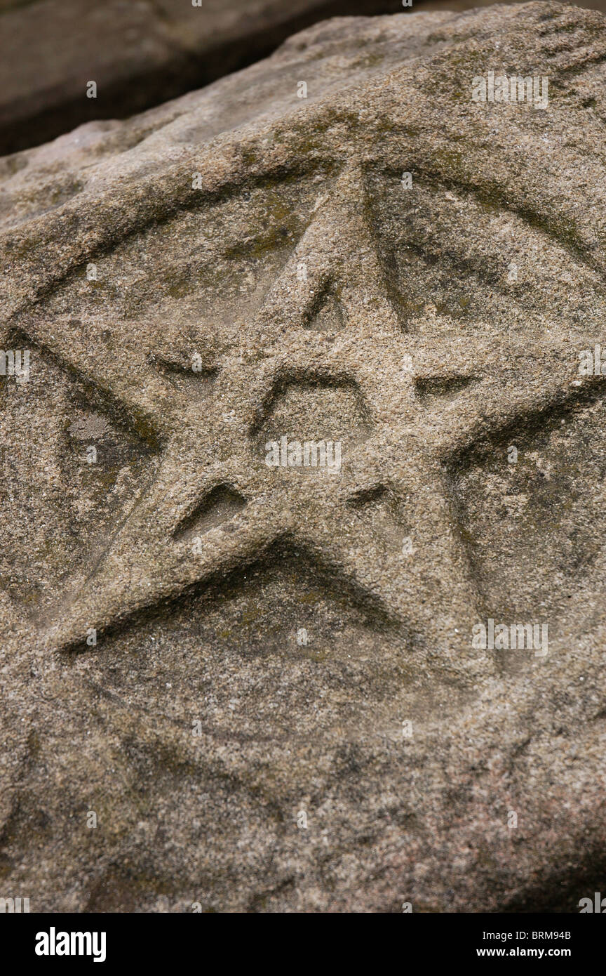 Funerary relief. Pentagram. Stone dated in 1284, from Rio Covo Santa Eugenia. Archaeological Museum. Barcelos. Portugal. - Stock Image