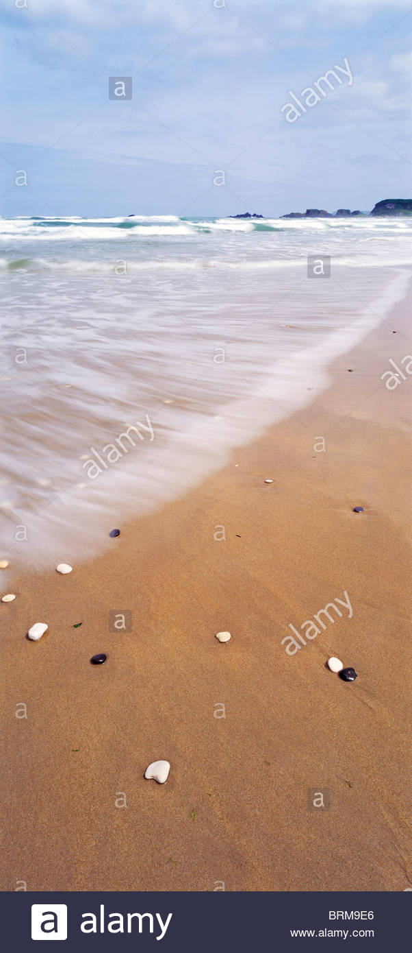 Pebbles on a beach. - Stock Image