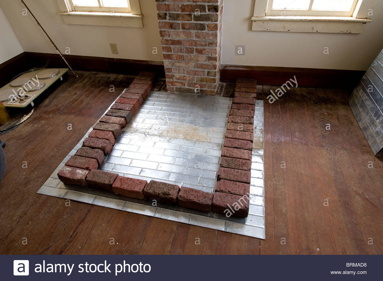 The base of a wood stove being built in an old farmhouse in Nebraska. - Stock Image