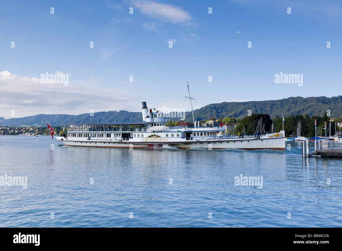 The paddle steamer,  Rapperswil,  leaving Zurich on the Zurichsee - Stock Image