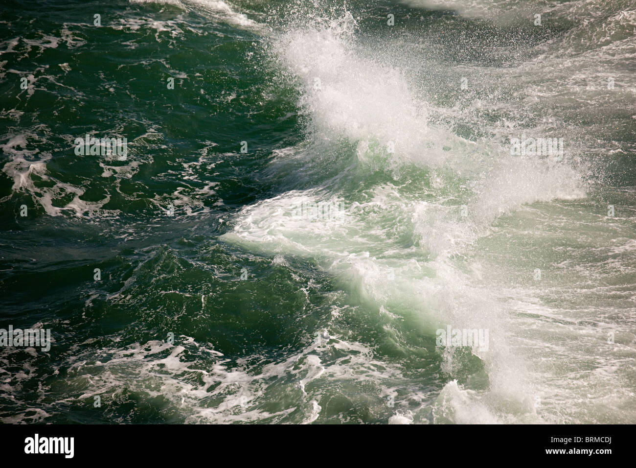 Spray from breaking wave - Stock Image