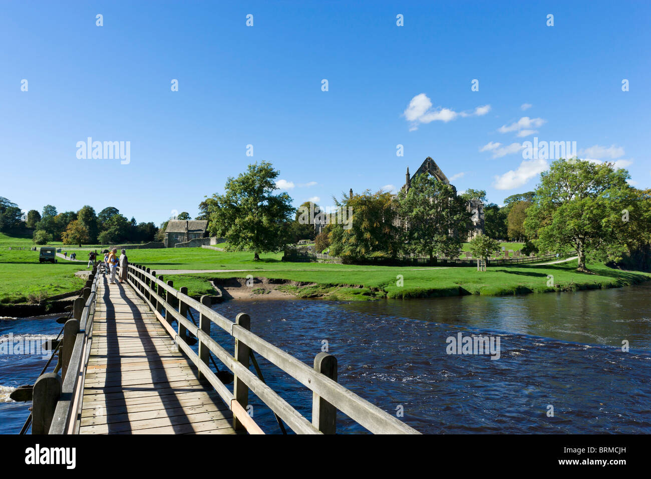 Bolton Priory viewed from the bridge over the River Wharfe, Bolton Abbey, Wharfedale, Yorkshire Dales, North Yorkshire, - Stock Image