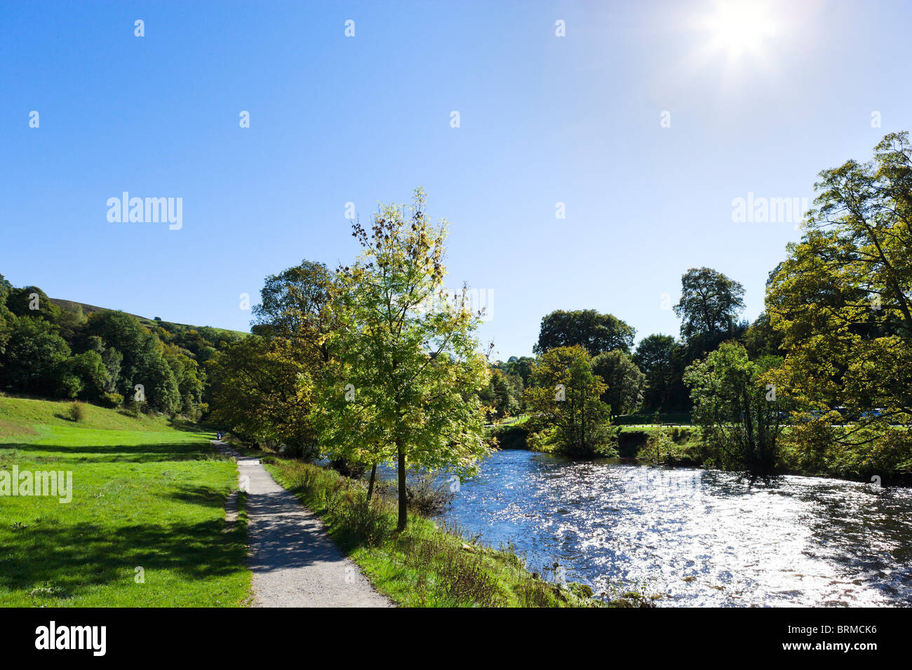 Dales Way path alongside the River Wharfe near the Cavendish Pavilion, Bolton Abbey, Wharfedale, Yorkshire Dales, - Stock Image
