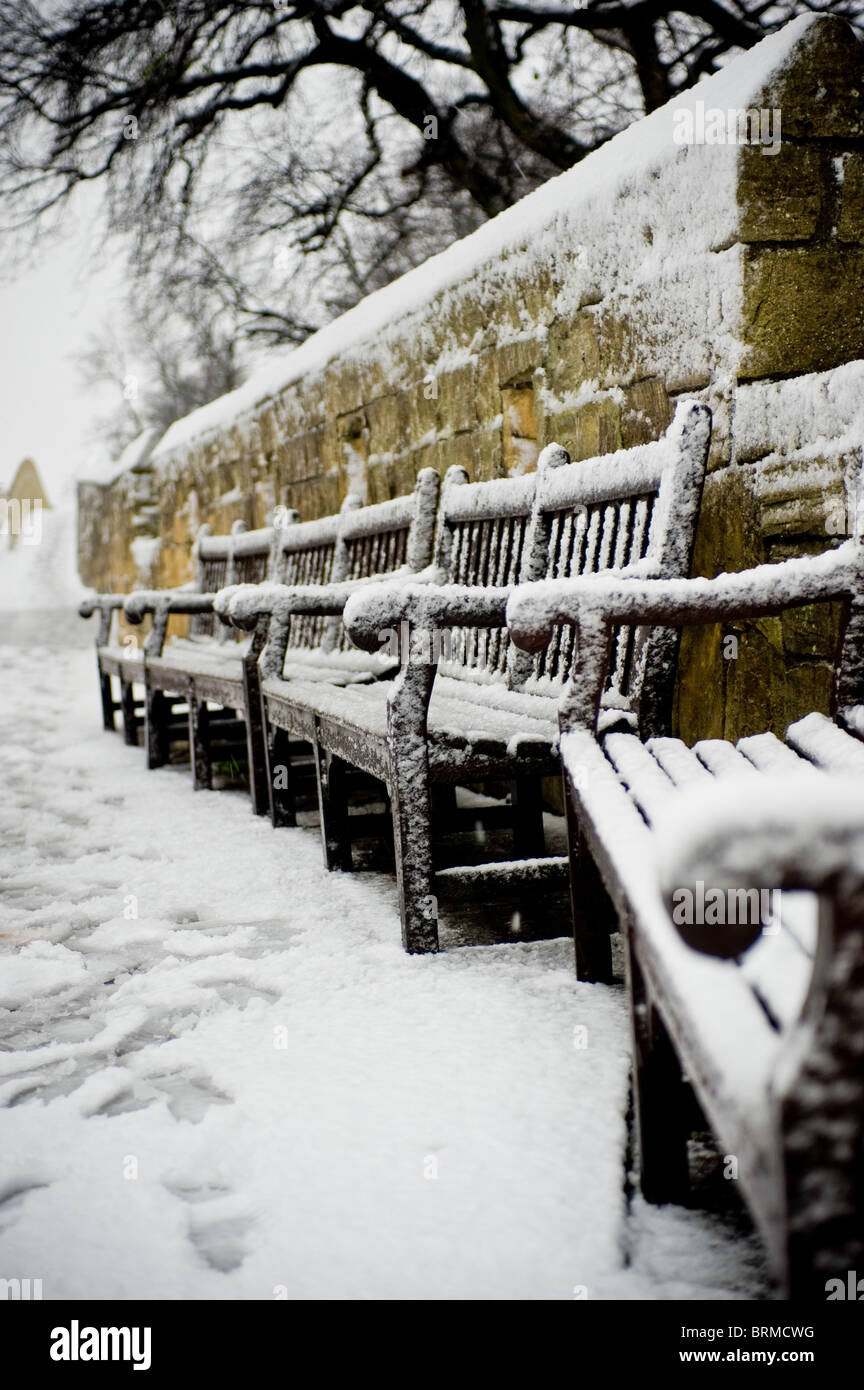 Wooden benches in snow on the Bar Walls - Stock Image