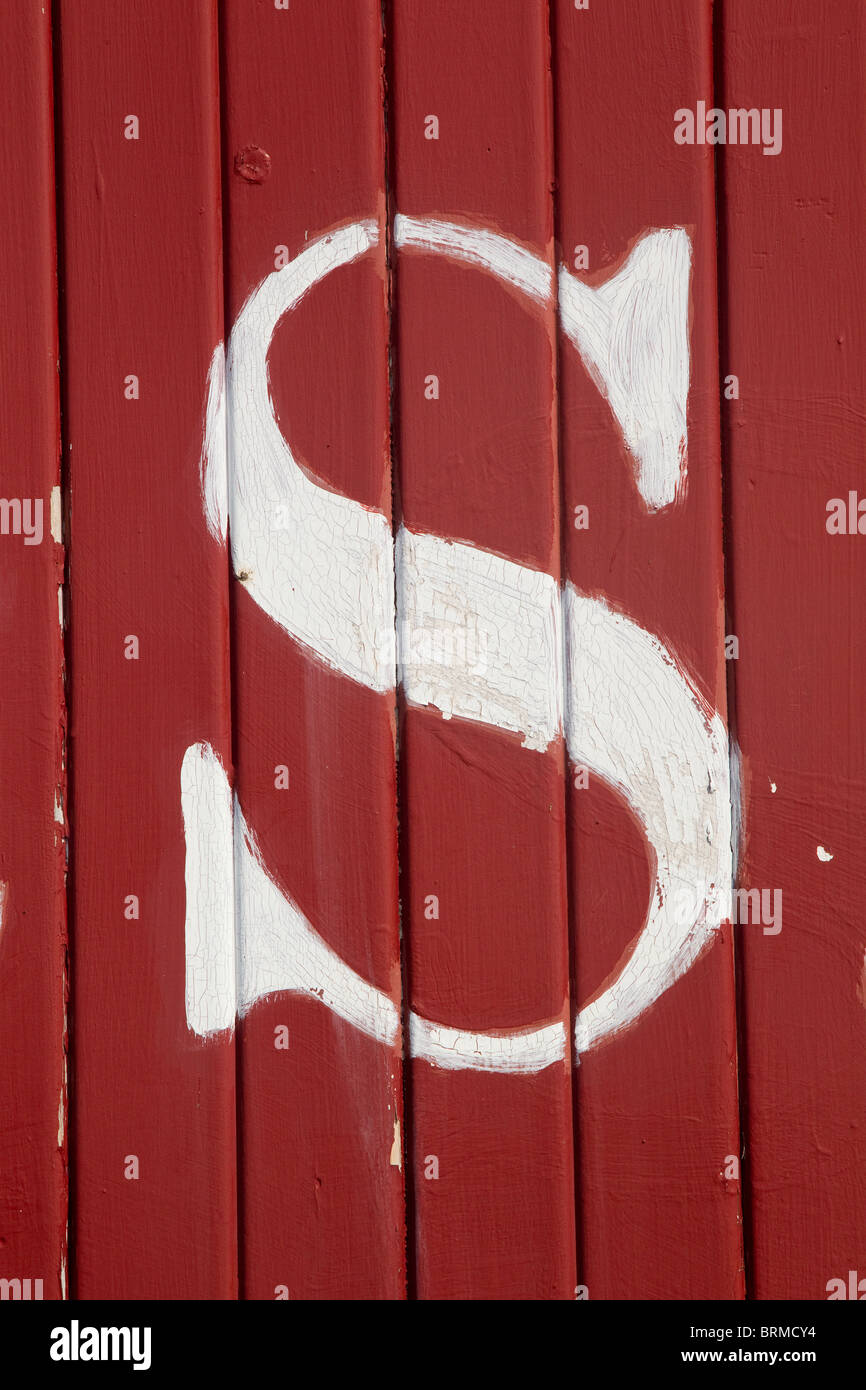 The letter S, white on red boards - Stock Image