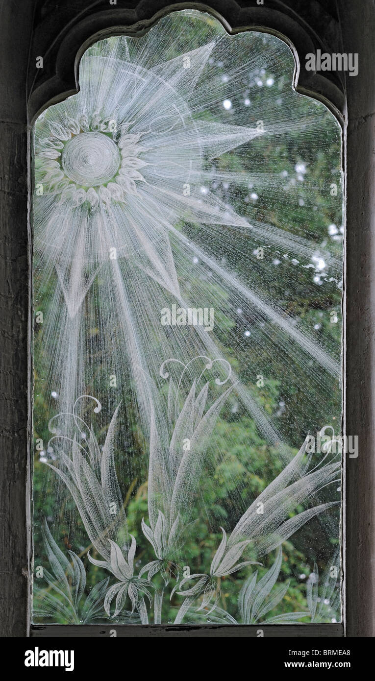 Sunrays etched in a memorial window of St Nicholas Church, Moreton, Dorset - Stock Image