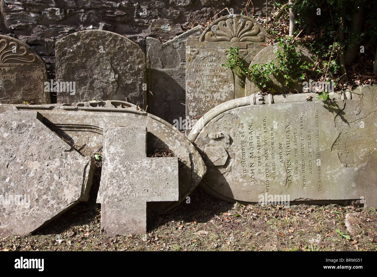 Gravestones removed from churchyard and stacked at side Talgarth Wales UK - Stock Image