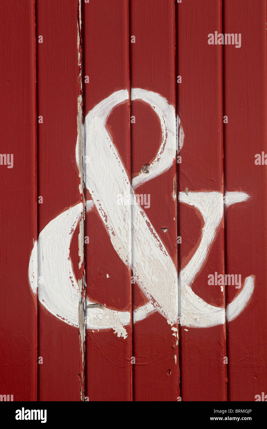 The letter &, word and, AND, white on red boards - Stock Image