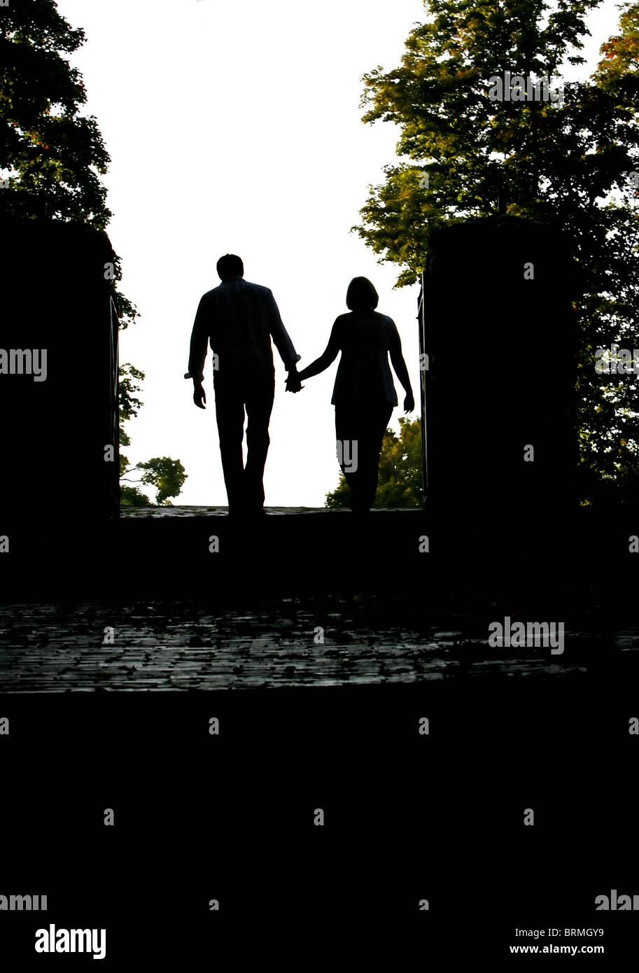 man walking away from a woman silhouette of a man and woman walking away as a couple 4958