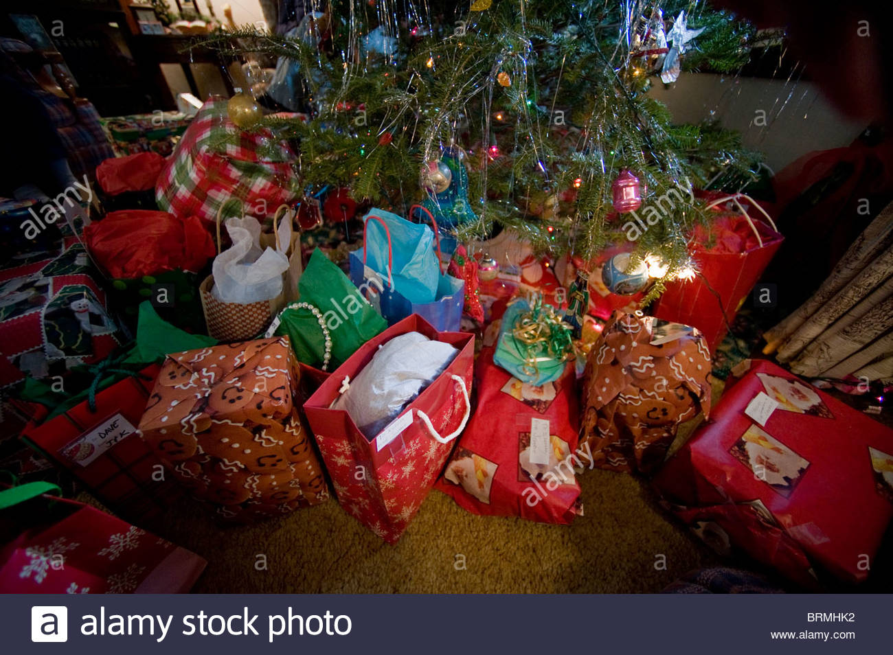 Christmas presents fill a living room on Christmas morning. - Stock Image