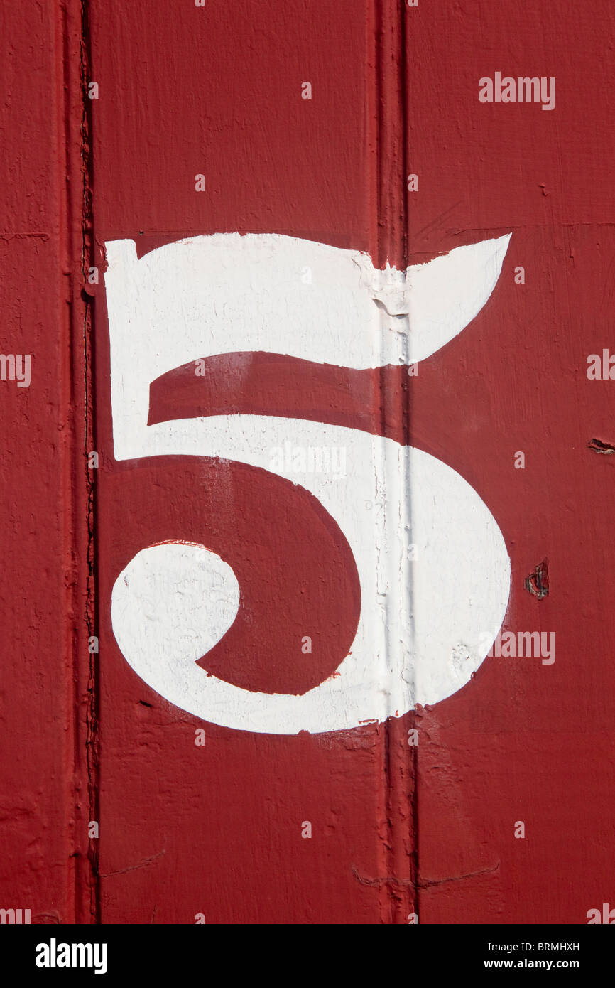 The number 5, white on red boards - Stock Image