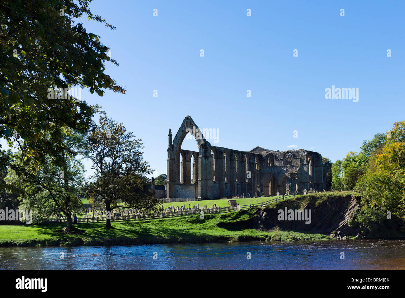 Bolton Priory viewed from over the River Wharfe, Bolton Abbey, Wharfedale, Yorkshire Dales, North Yorkshire, England, - Stock Image