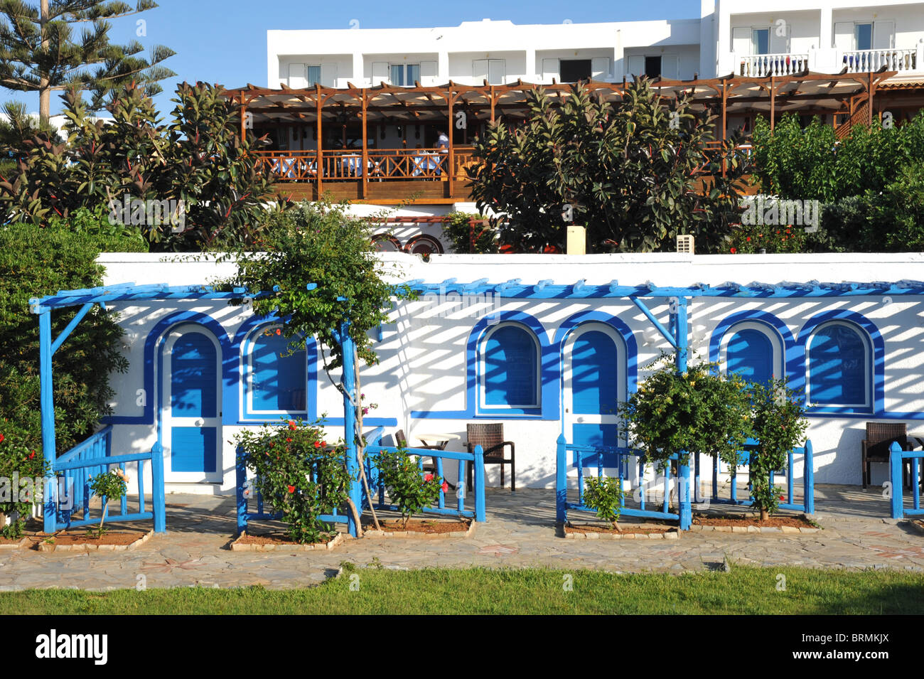 Traditional Greek style bungalow holiday hotel accomodation. Image taken in Crete, Greece - Stock Image