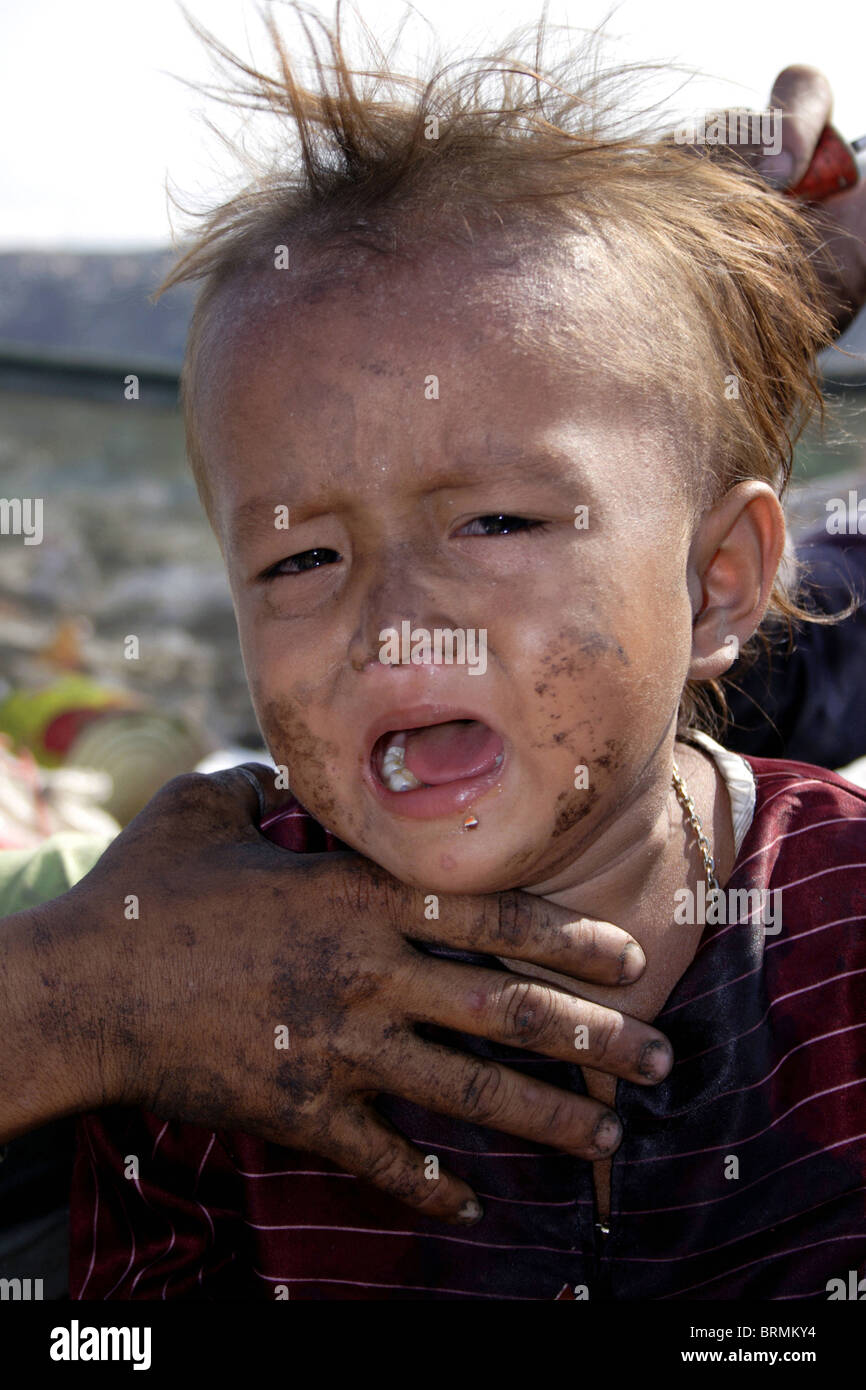 36a006ca21a6 A young child laborer boy is crying in a garbage dump at The Stung Meanchey  Landfill