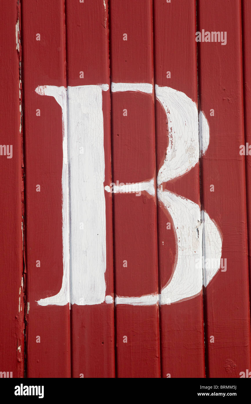 The letter B, white on red boards - Stock Image