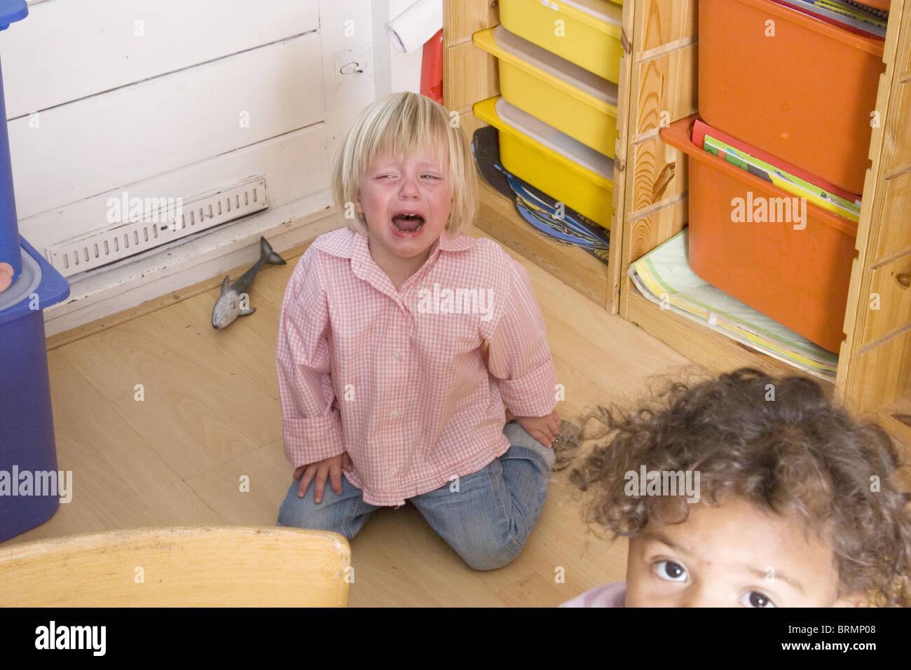 Brat child giving a toddler tantrum at toddler group - Stock Image