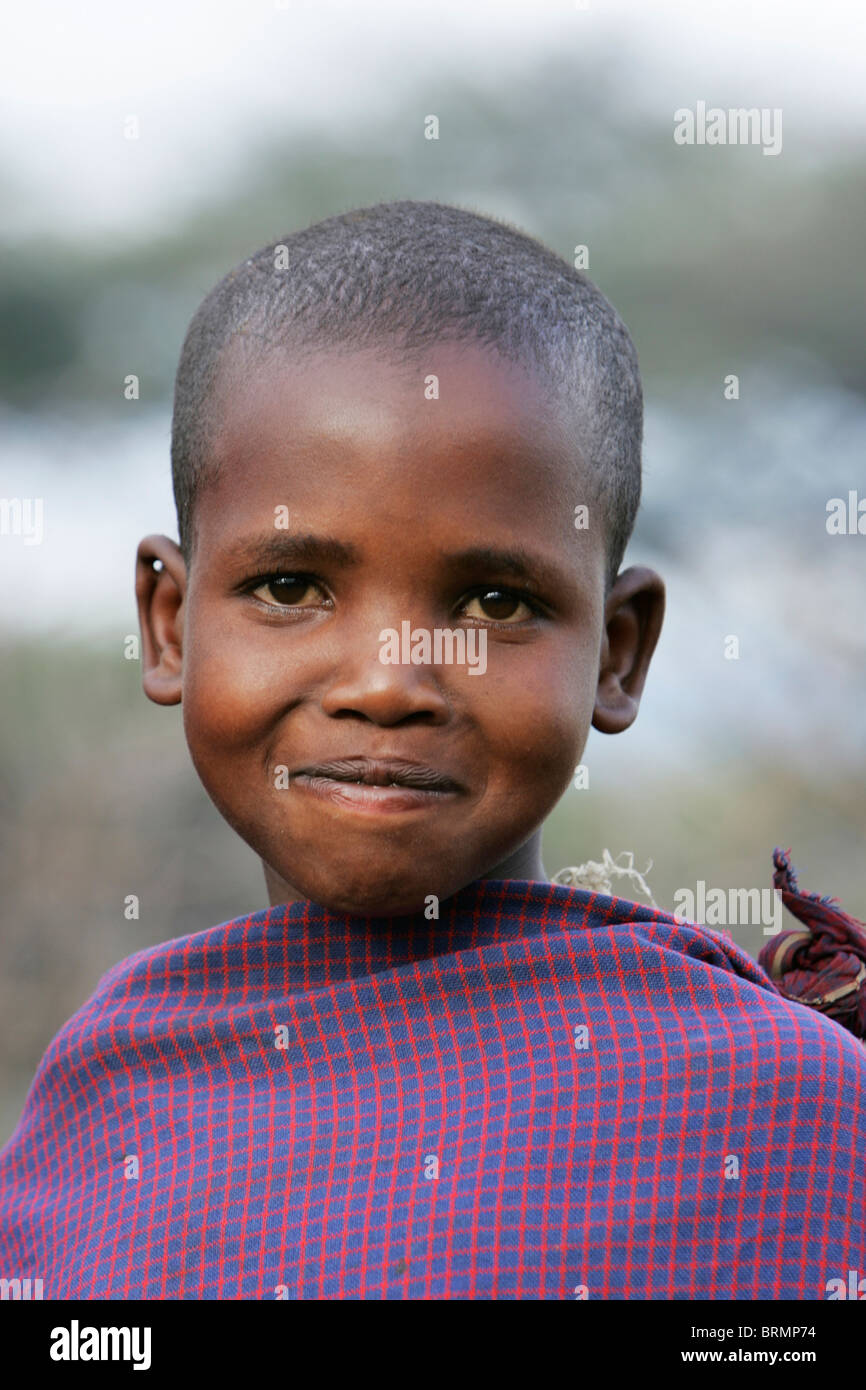 Maasai child aged about 7 year old and wrapped in a traditional shuka - Stock Image