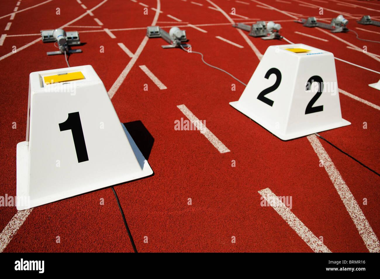 empty starting blocks on running track - Stock Image