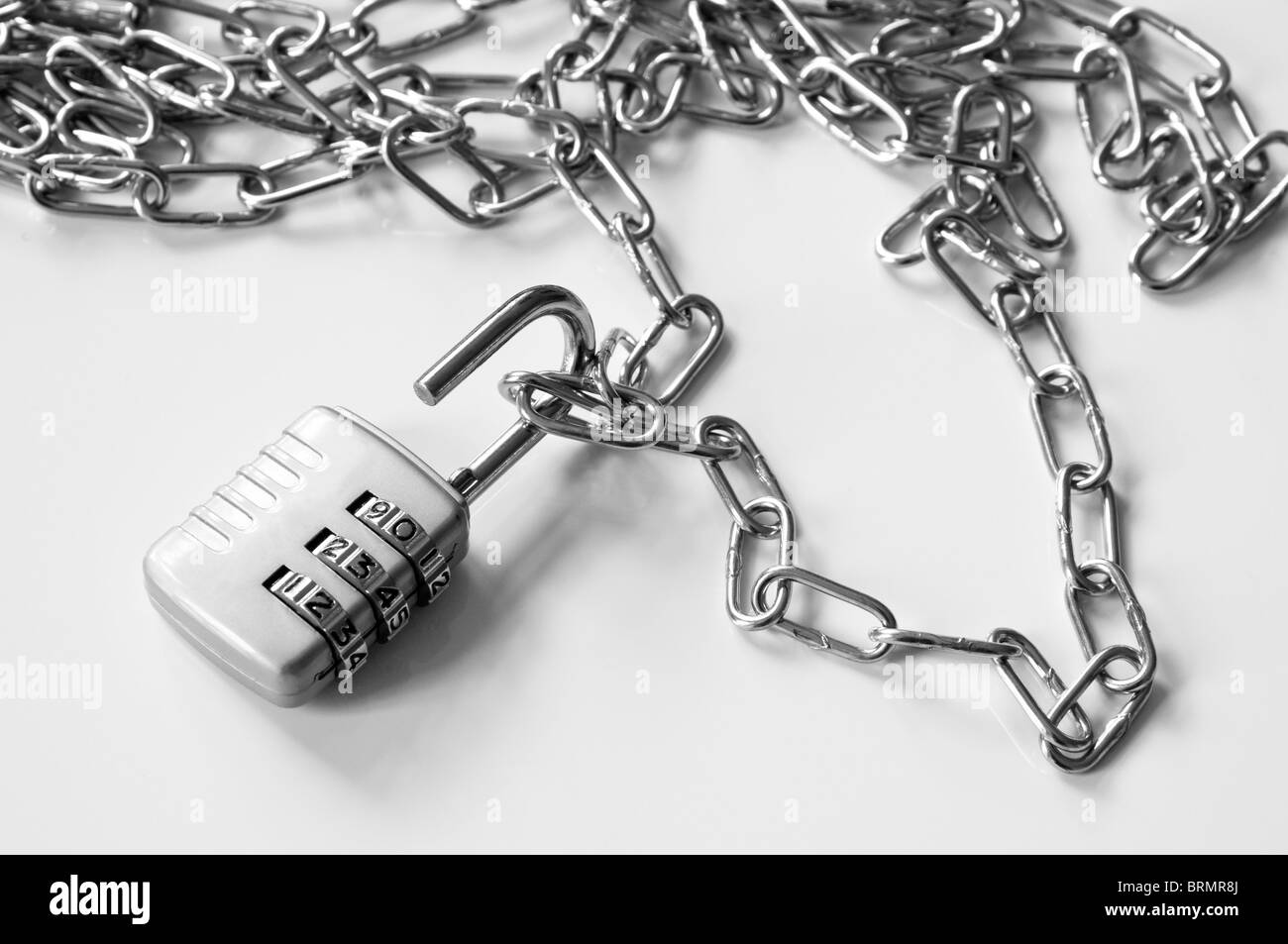 Unlocking a chain. - Stock Image